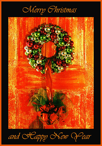 Christmas wreath on orange door